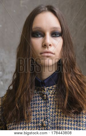 MILAN ITALY - FEBRUARY 27: Gorgeous model poses in the backstage just before Daizy Shely show during Milan Women's Fashion Week on FEBRUARY 27 2017 in Milan.