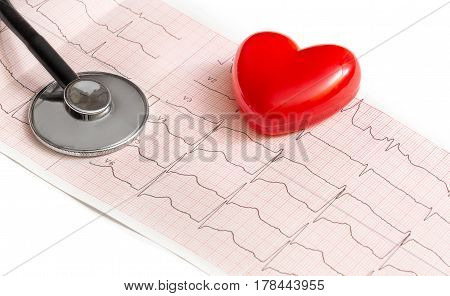 Heart with stethoscope on the paper cardiogram.