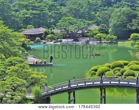 Kagawa, Japan - July 22, 2016: A view from a hill in Ritsurin Garden in Takamatsu city, Kagawa Prefecture, Japan. Ritsurin Garden is one of the most famous historical gardens in Japan.