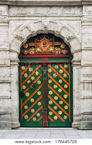 Ornate medieval door. Entrance to the house of Brotherhood of Blackheads Tallinn Estonia
