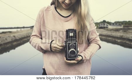 Woman wanderlust with vintage retro camera