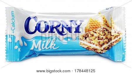 MOSCOW RUSSIA - MARCH 24 2017: Corny Milk (honey and calcium) muesli bar isolated on white background with clipping path. Corny Milk are produced by Schwartauer Werke (Hero group).