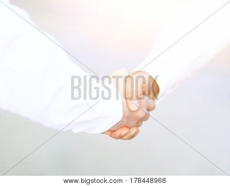 Two business men shaking hands in the office