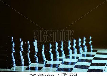 Composition with chessmen on the glossy chessboard