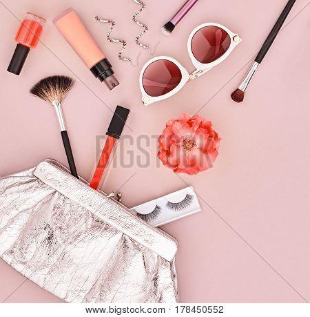 Fashion Makeup Cosmetic Set. Woman Beauty Accessories Set. Makeup Essentials. Fashion Design. Lipstick Brushes Eyeshadow, fashion Glamor Stylish Clutch. Rose.Minimal Concept.Top view.Cosmetic Overhead