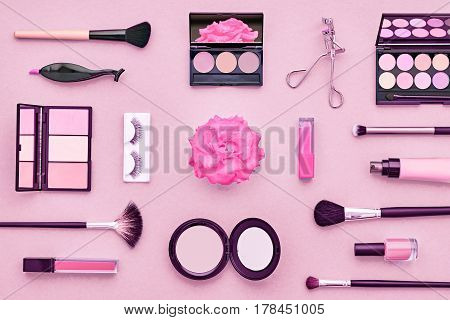 Fashion Cosmetic Makeup Set. Woman Beauty Accessories Set. Essentials. Makeup background. Fashion Design. Lipstick Brushes Eyeshadow, fashion Eyelashes, Rose. Minimal Concept.Top view.Cosmetic Overhead