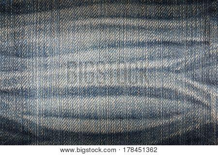 Denim jeans texture, denim jeans background. Old grunge vintage denim jeans. Stitched texture denim jeans background of fashion jeans design. Dark edged.