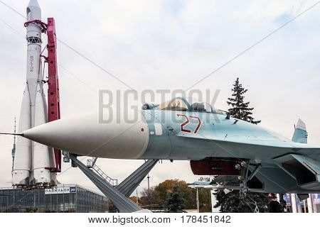 Moscow, Russia - October 20, 2016: Su-27 fighter aircraft and the first cosmonaut Vostok missile at the VDNKh exhibition in Moscow.
