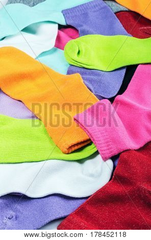 Bright multicolored socks textile background. Home textiles