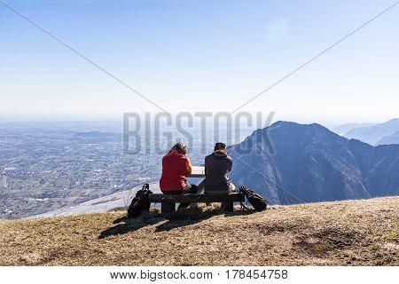 Hikers taking a break on Monte San Simeone with nice view to Friuli-Venezia Giulia