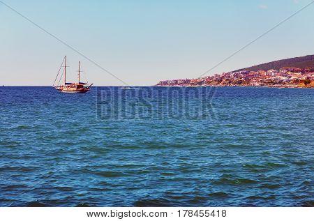 Seascape with a ship. Sunny summer day on the Bulgarian Black Sea coast.