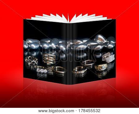 book of wedding rings on a black background