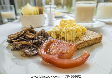 Breakfast With Tomato, Mushroom, Scramble Eggs On Toast
