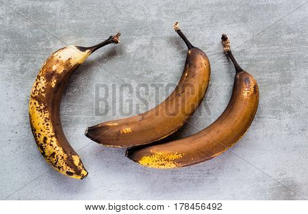 Brown Bananas On A Concrete Table