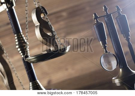 Law and justice theme, scale of justice on wooden backgrund