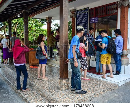 People Waiting At The Ticket Booth In Bali, Indonesia