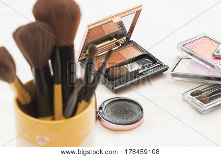 brush for cosmetics makeup skin face on background whie