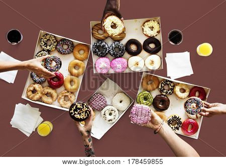 Group of hands holding sweeten donut dessert