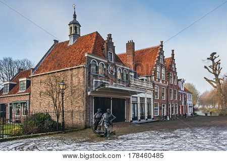 EDAM, NORTH HOLLAND/ THE NETHERLANDS - January 16, 2017: The historic building of Waag (Scales) in the Dutch town of Edam in winter