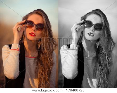 Sunny happy brunette glamour girl with wearing sunglasses corrects holds modern new stylish brown sunglasses. Woman good taste. Sunset. Summer time.Glamour Sunglasses. Original sunglasses.Trend excellent.