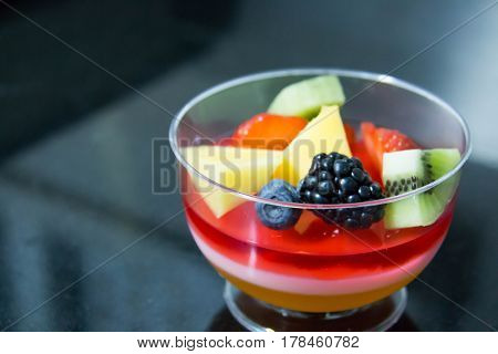 Fruit jelly in glass bowls with fresh berry