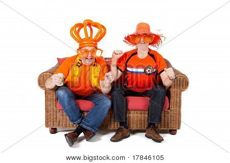 Two Dutch soccer fan watching game over white background poster