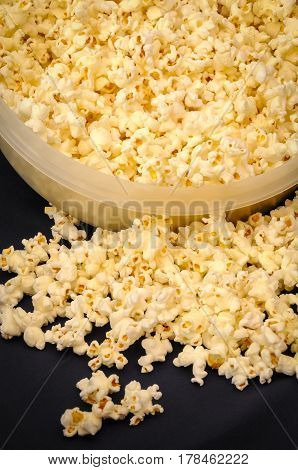 A close up of popped popcorn in bowl ready to eat