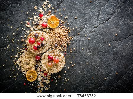 Round Crisp On A Black Stone Background. Berries And Fruit Top.