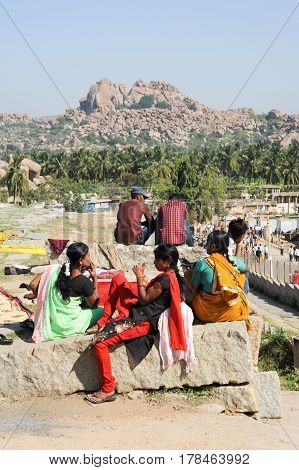 Indian Girls Sitting Outside Of A Temple At Hampi