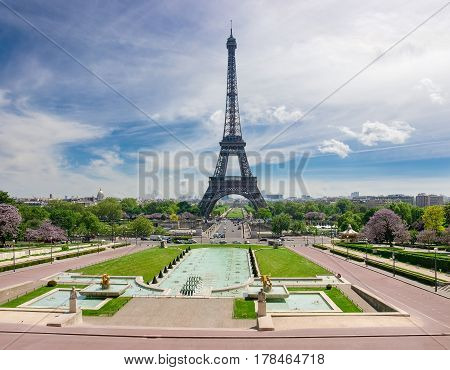 View of the Eiffel Tower from the Trocadero Squareon the background of the sky with clouds in spring in Paris France.