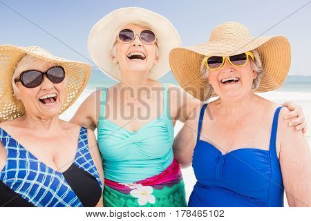 Portrait of senior woman friends on the beach
