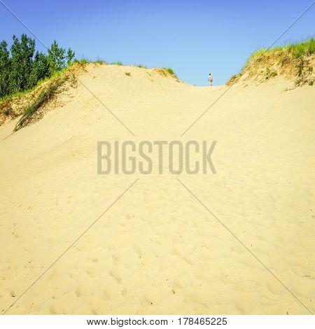 Woman is hiking in Sleeping Bear Dunes in Northern Michigan