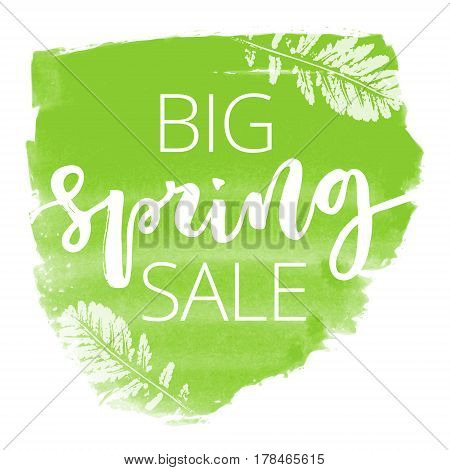 Big spring sale white hand written inscription with leaves on green watercolour banner background