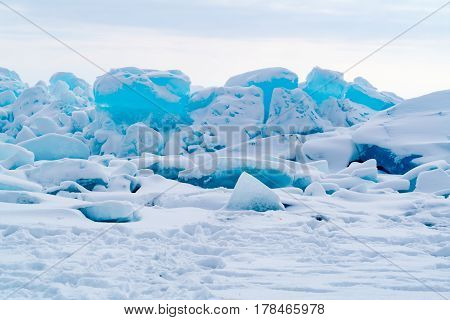 View of ice blocks cover with snow at Frozen Lake Baikal in Russia