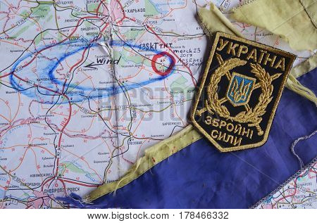 Chevron of Ukraine army.Back-Map of Ukraine  with location of Balakleya .Place of arsenal explosion at 23 march. 138 kT. of TNT power.March 23 ,2017 in Kiev, Ukraine