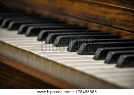 A close up of a keyboard of a grand piano