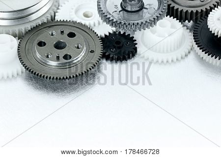 Plastic Gear Cogwheels For Industry On Scratched Background