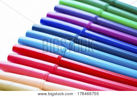 Colorful markers pens on the white background.