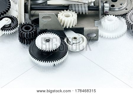 Industrial Black And White Plastic Gears On Scratched Background