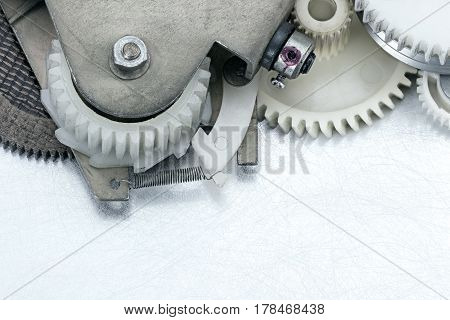Plastic Machinery Gear Cogwheels On Scratched Background