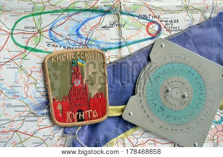 .Chevron of Ukraine army.Back-Map of Ukraine  with location of Balakleya .Place of arsenal explosion at 23 march. 138 kT. of TNT power.March 25 ,2017 in Kiev, Ukraine
