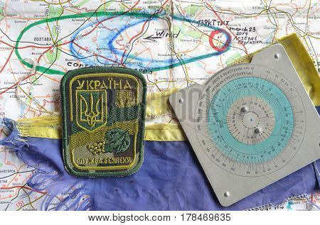Chevron of Ukraine army.Back-Map of Ukraine  with location of Balakleya .Place of arsenal explosion at 23 march. 138 kT. of TNT power. March 25 ,2017 in Kiev, Ukraine