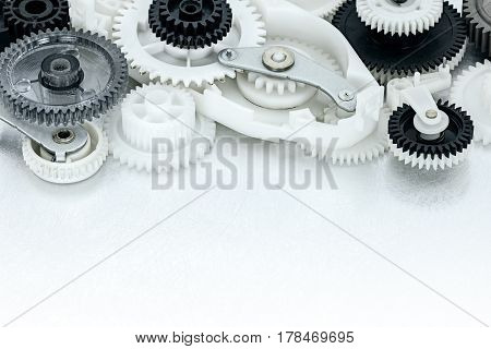 Metal And Plastic Cogwheels And Other Parts Of Industrial Machinery