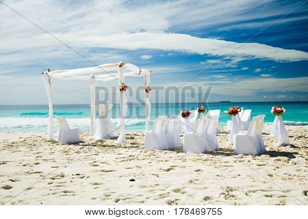 Wedding preparations outdoors, at tropical sandy beach