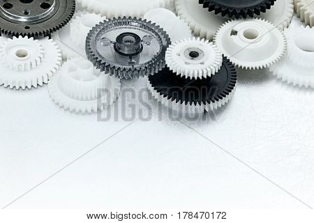 Plastic Gear Cogwheels On Scratched Industrial Background