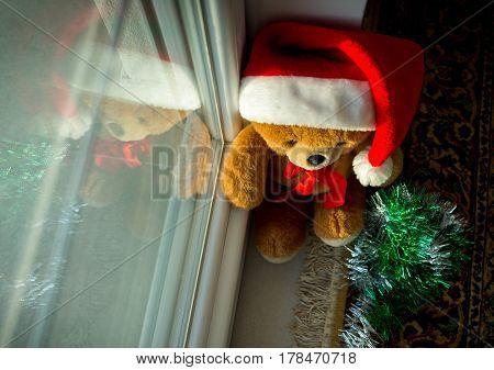 Santa Teddy Bear at home waiting for Christmas