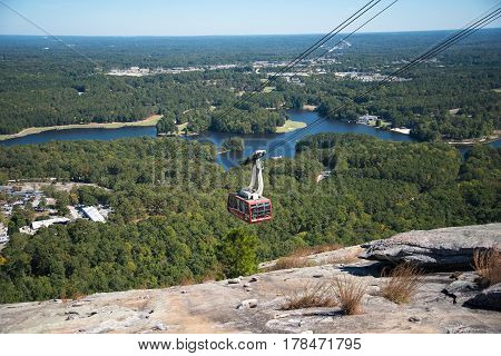 Cable Car traveling down stone mountain in georgia with landscape background