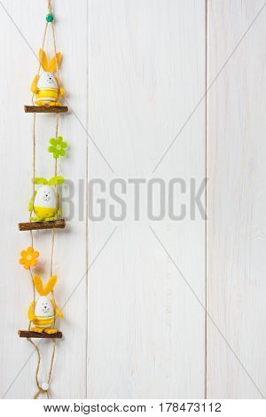 Three Happy Easter Bunny Eggs Decoration On White Wooden Background.