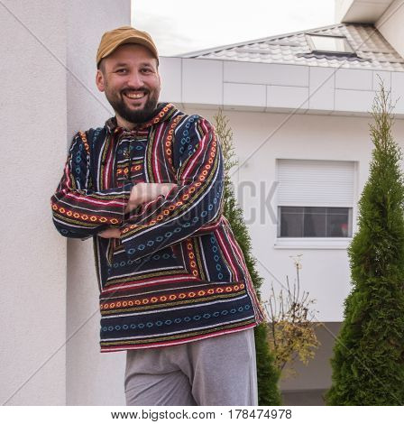Man living his dream in front of his new modern house