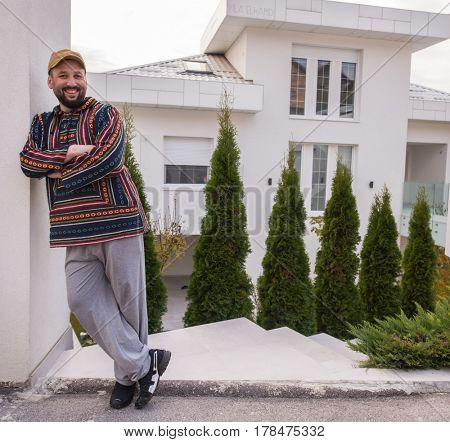 Man in front of his home outdoors